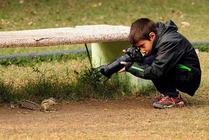 niño fotografo